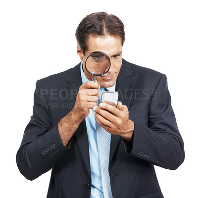 Buy stock photo A mature businessman using a magnifying glass to read a text message against a white background