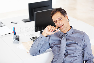 Buy stock photo Portrait of a mature male business executive sitting at desk in office and thinking