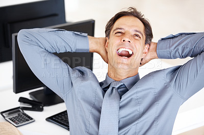 Buy stock photo Portrait of relaxed mature businessman laughing during break time at work