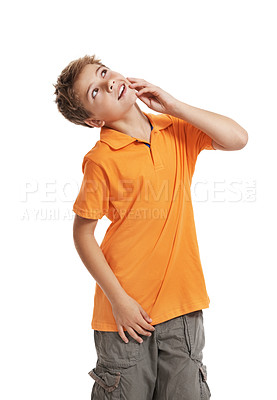 Buy stock photo Naughty little kid looking up at copyspace against white background
