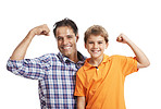 Happy father and son flexing their biceps isolated on white