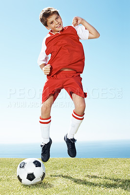 Buy stock photo Portrait of a happy small football player jumping in joy - Outdoor