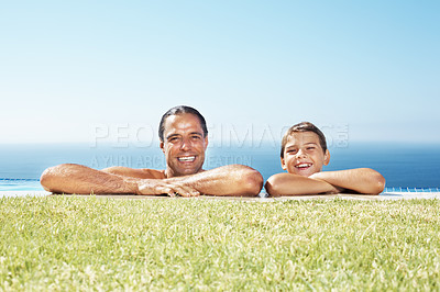 Buy stock photo Portrait of a smiling father and cute son in swimming pool enjoying their holidays
