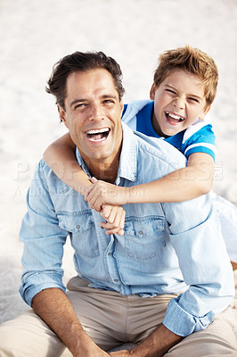 Buy stock photo Excited little kid holding his father from behind at the beach