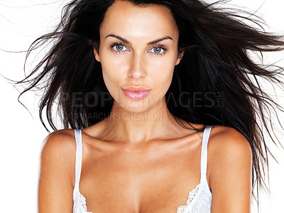 Buy stock photo Portrait of a sexy young woman in lingerie with an arresting gaze, isolated against white background