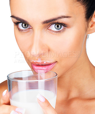 Buy stock photo Closeup of a pretty young woman holding a glass of fresh milk against white background