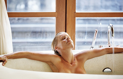 Buy stock photo Attractive middle aged woman relaxing in Jacuzzi at spa