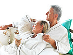 Lovely mature couple enjoying coffee in bedroom