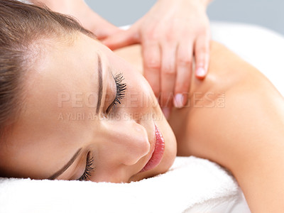 Buy stock photo Getting a massage - with face. Portrait of a pretty young woman getting a massage at the day spa