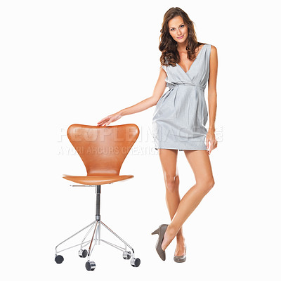 Buy stock photo Full length of confident woman standing with legs crossed and hand on chair against white background