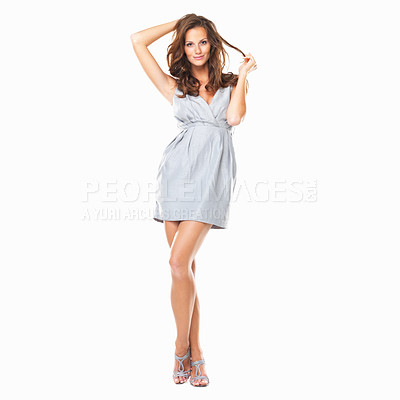 Buy stock photo Full length image of beautiful woman standing with legs crossed and playing with her hair on white background