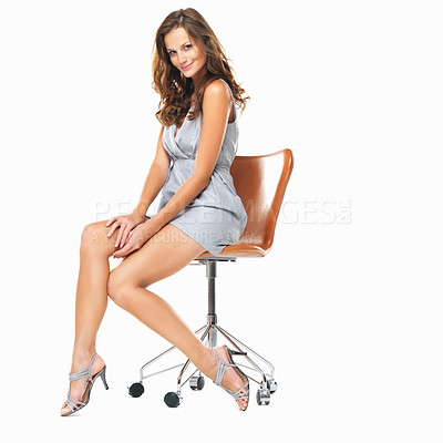 Buy stock photo Full length of beautiful young lady sitting on chair and smiling against white background