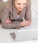 Woman lying in front of laptop