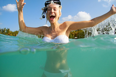 Buy stock photo Portrait of an excited young woman in the ocean wearing snorkelling gear