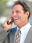 Old business man talking on mobile phone