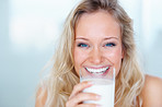 Closeup portrait of a young girl drinking a glass of milk