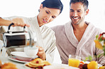 Couple at breakfast table