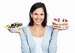 Smiling woman with cake and salad