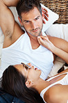 Couple with sunglasses in bed