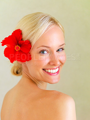 Buy stock photo Portrait of beautiful woman with a red flower in her hair