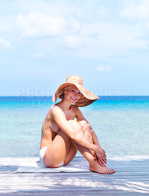 Buy stock photo Portrait of topless young woman sitting on a beach wearing a hat