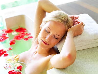 Buy stock photo Portrait of relaxed young lady getting a treatment at a spa center