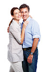 A cute mature couple in love hugging over white background