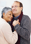 Cute elderly couple embracing eachother
