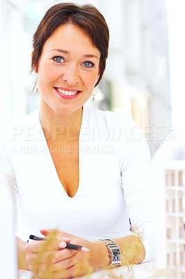 Buy stock photo Cropped shot of a female architect working on a new building plan