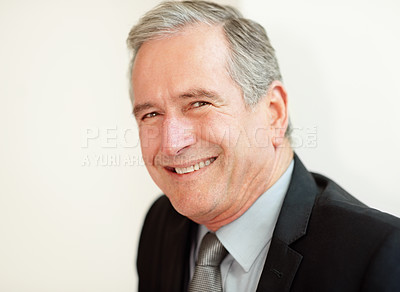 Closeup of a happy mature business man giving you a smile