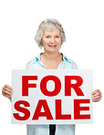 Happy senior woman holding sale sign on white