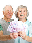 Happy elderly couple holding currency motes