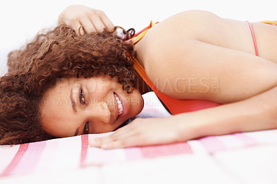 Buy stock photo Portrait of a happy woman lying on a deck and smiling