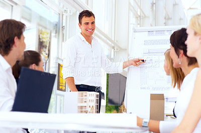Buy stock photo Cropped shot of a group of coworkers listening to their colleague's presentation
