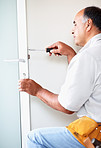 Experienced handyman fixing a lock on a door
