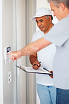 Newly fit house alarm - Middle aged man with a maintenance guy