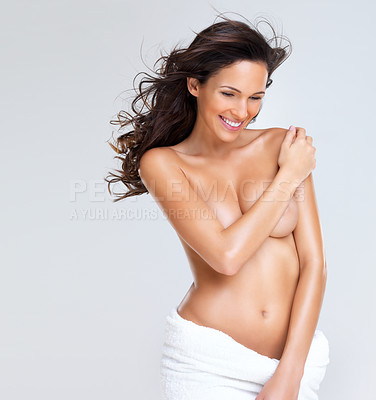 Buy stock photo Portrait of lovely young woman smiling while covering her breasts
