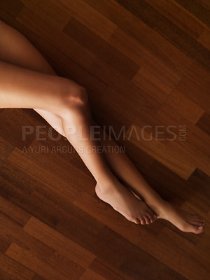 Buy stock photo High angle view of woman's long toned legs