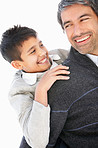 Father carrying happy son on back over white