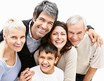 Portrait of a cheerful boy with loving parents and grandparents