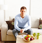 Modern lifestyle - young man sitting on couch