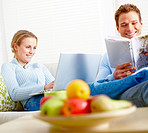 Modern lifestyle - Happy couple relaxing at home