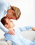 Young blond kissing a young man at home
