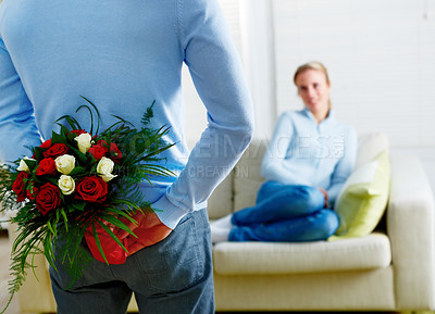Buy stock photo Rearview of a man about to surprise his wife with a bunch of roses - copyspace