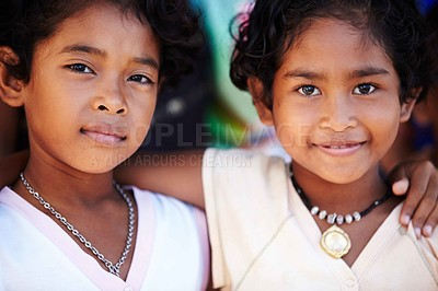 Buy stock photo Portrait of two happy young girls from Thailand embracing each other