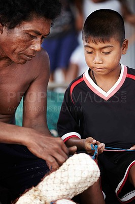 Buy stock photo Portrait of a fisherman from rural Thailand teaching his young son his work