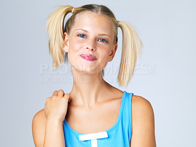 Buy stock photo Portrait of attractive young blonde in pigtails