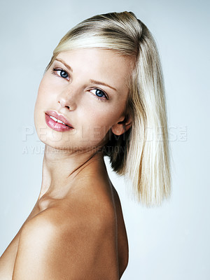 Buy stock photo Pretty blonde woman posing while isolated on a grey background