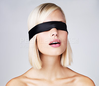 Buy stock photo Cropped image of a blind folded young blond female isolated on light grey