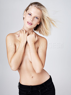 Buy stock photo Pretty topless young woman posing on a grey background